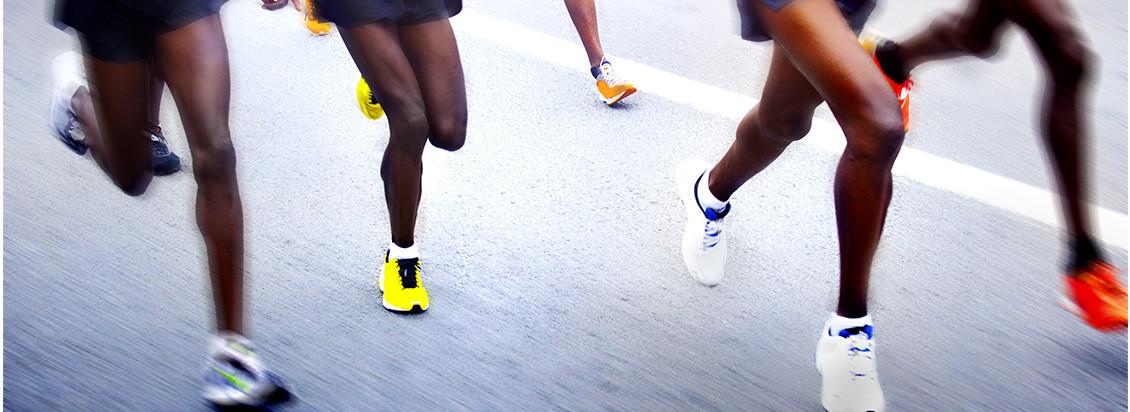 Photo of marathon runners legs